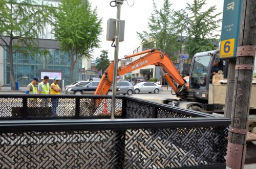 Four men digging a hole in Seoul, Korea. Not revealing the fifth that stands behind... Photo by Erik Winther